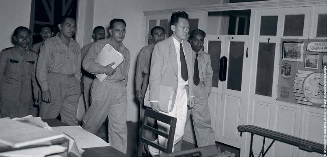 Mr Lee leaving the conference room at the Colonial Secretary's Office with the executive committee members of the Postal and Telecommunications Uniformed Staff Union in 1952.