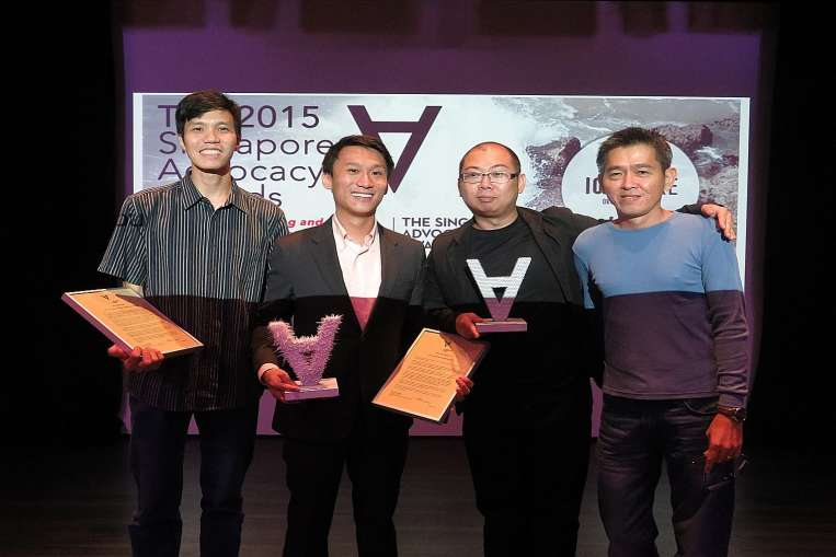 Civil society advocate of the year Remy Choo Zheng Xi (second from left) with civil society advocate organisation of the year The Online Citizen's editors (from left) Howard Lee, Terry Xu and Andrew Loh attending the awards event yesterday.PHOTO: SINGAPORE ADVOCACY AWARDS